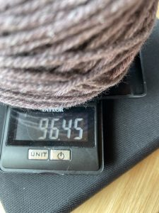 purple yarn on yarn scale