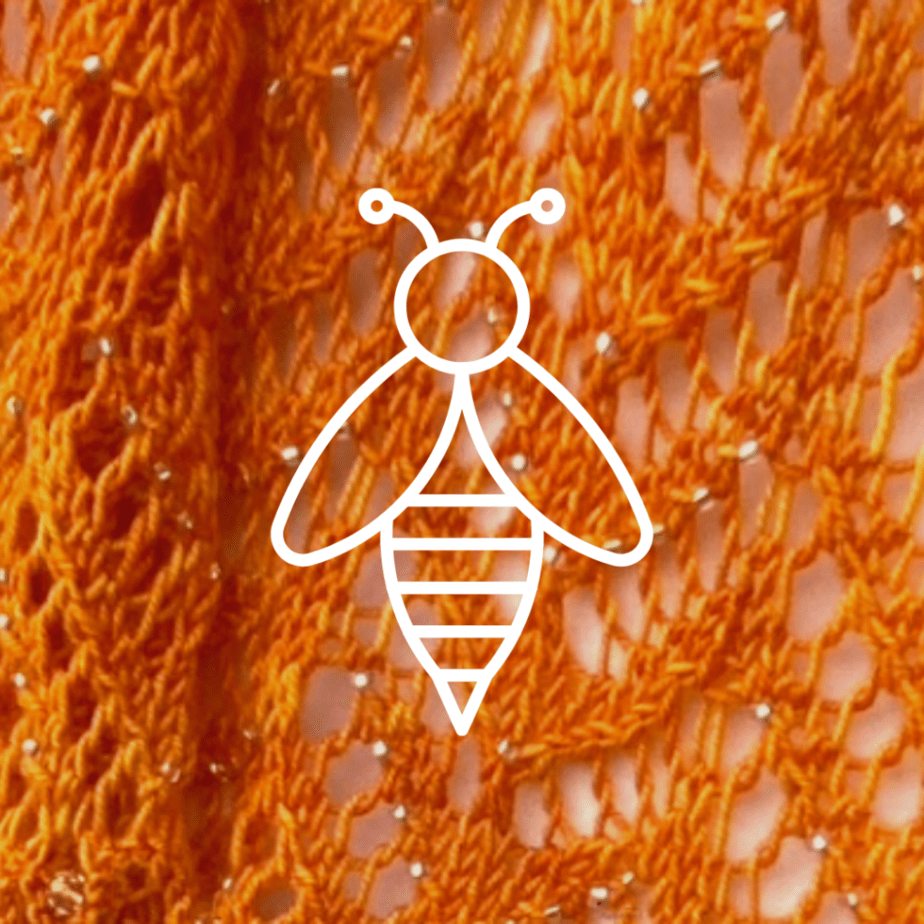 bee image on knitted background