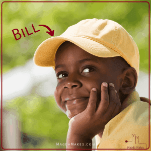 boy wearing hat with a bill