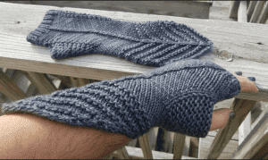 Hand wearing hand knit Demi-Gaunt FIngerless gloves