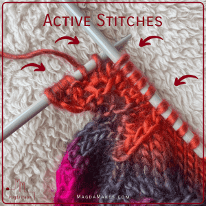 red knititng on a fuzzy background with the Activie stitches and arrows to the active stitches