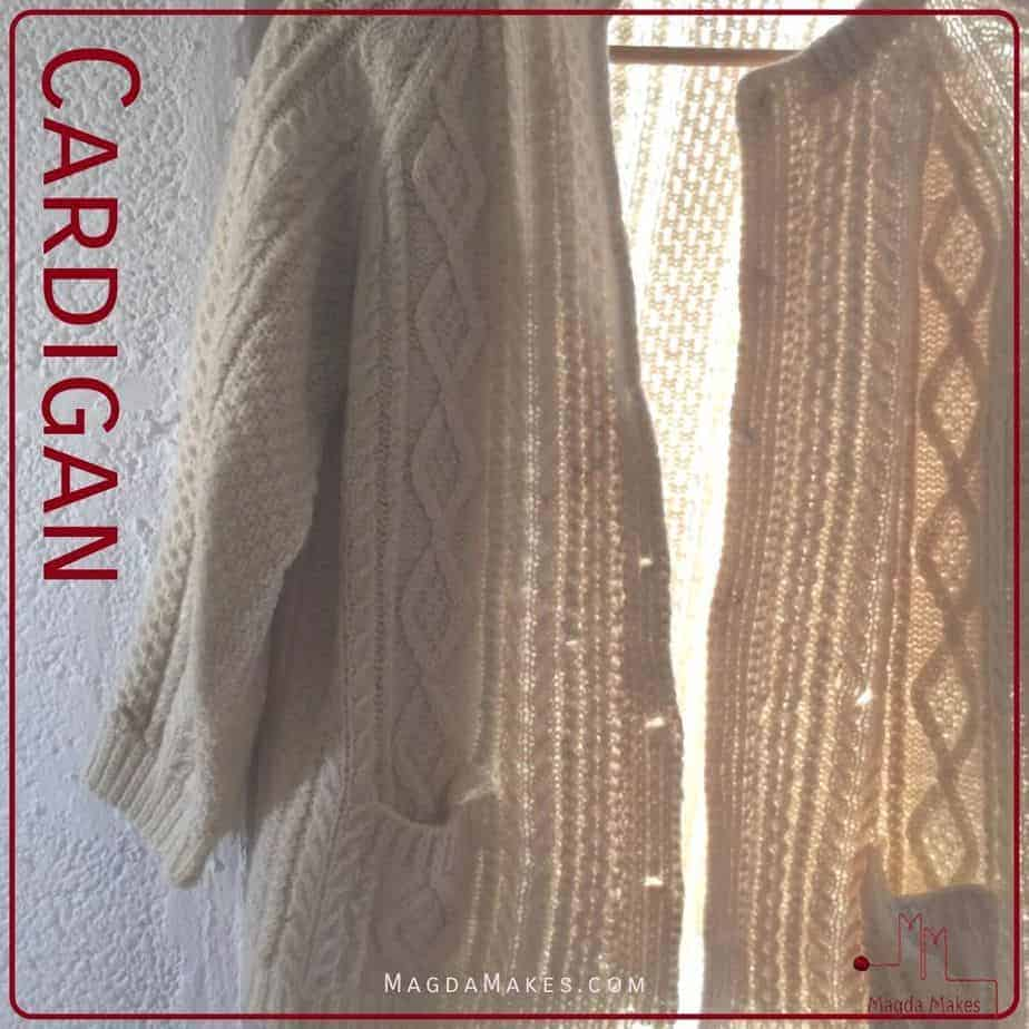 Cardigan backlight in a window for A Knitting Dictionary the letter C