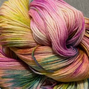 A swirl of variegated Lonesome Dove yarn by Blue Mule Fibers