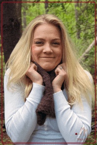 Woman in the woods wearing a lace knit cowl