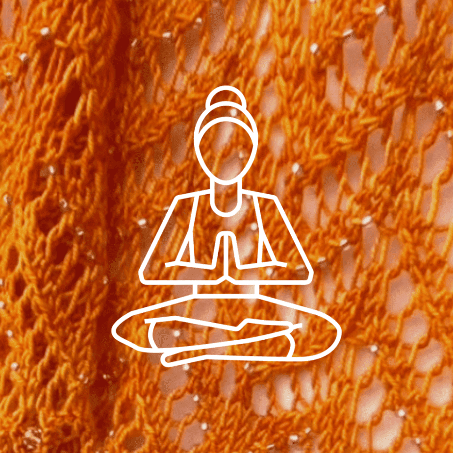 Meditating person on knitted background