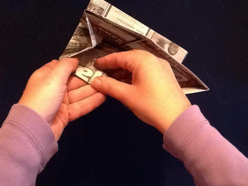 A hand applying tape.